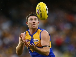 JEREMY MCGOVERN of the Eagles marks the ball during the AFL match between the West Coast Eagles and the Sydney Swans at Optus Stadium in Perth, Australia.