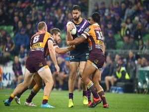 Jesse Bromwich of the Melbourne Storm is tackled during the NRL match between the Melbourne Storm and the Brisbane Broncos at AAMI Park in Melbourne, Australia.