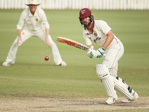 JOE BURNS of Queensland plays a shot during the Sheffield Shield final match between Queensland and Tasmania at Allan Border Field in Brisbane, Australia.