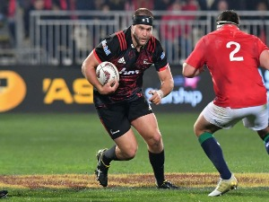 JOE MOODY of the Crusaders charges forward during the match between the Crusaders and the British & Irish Lions at AMI Stadium in Christchurch, New Zealand.