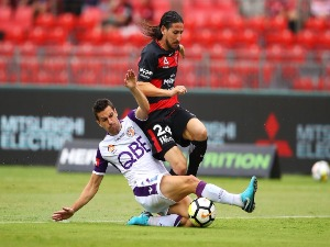 JOEL CHIANESE of the Glory tackles RAUL LLORENTE of the Wanderers during the A-League match between the Western Sydney Wanderers and the Perth Glory at Spotless Stadium Sydney, Australia.