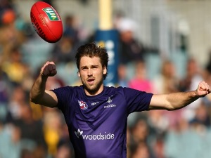 JOEL HAMLING of the Dockers warms up before the AFL match between the Fremantle Dockers and the West Coast Eagles at Domain Stadium in Perth, Australia.