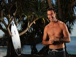 ASP World Champion JOEL PARKINSON poses during a portrait shoot at Duranbah Beach in Tweed Heads, Australia.