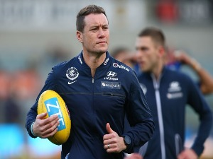 JOHN BARKER, assistant coach of the Blues warms the players up during the round 21 AFL match between the West Coast Eagles and the Carlton Blues at Domain Stadium on August 12, 2017 in Perth, Australia.