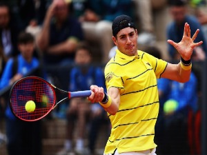 JOHN ISNER of USA returns a forehand in his match against Albert Ramos-Vinolas of Spain during the Internazionali BNL d'Italia 2018 tennis at Foro Italico in Rome, Italy.