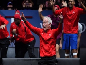 JOHN MCENROE, Captain of Team World celebrates as John Isner of Team World wins match point during his mens singles match against Rafael Nadal of Team Europe on the final day of the Laver cup in Prague, Czech Republic.