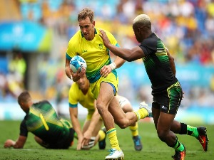 JOHN PORCH of Australia runs the ball during the Rugby Sevens match between Australia and Jamaica of the Gold Coast 2018 Commonwealth Games at Robina Stadium on the Gold Coast, Australia.