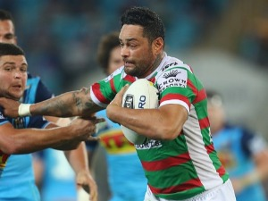 JOHN SUTTON of the Rabbitohs makes a break during the NRL match between the Gold Coast Titans and the South Sydney Rabbitohs at Cbus Super Stadium in Gold Coast, Australia.