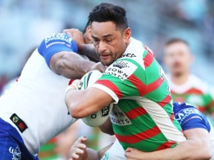 JOHN SUTTON of the Rabbitohs is tackled during the NRL match between the Canterbury Bulldogs and the South Sydney Rabbitohs at ANZ Stadium in Sydney, Australia.