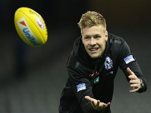 JORDAN DE GOEY of the Magpies marks the ball before warm up during the AFL match between the Collingwood Magpies and the North Melbourne Kangaroos at Etihad Stadium in Melbourne, Australia.
