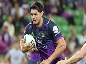 JORDAN MCLEAN of the Melbourne Storm runs with the ball during the NRL match between the Melbourne Storm and the Brisbane Broncos at AAMI Park in Melbourne, Australia.