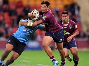 JORDAN PETAIA of the Reds is tackled during the Super Rugby match between the Reds and the Waratahs at Suncorp Stadium in Brisbane, Australia.
