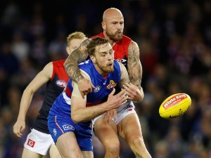 NATHAN JONES of the Demons and JORDAN ROUGHEAD of the Bulldogs compete for the ball during the 2017 AFL match between the Western Bulldogs and the Melbourne Demons at Etihad Stadium in Melbourne, Australia.