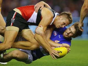 JORDAN ROUGHEAD of the Bulldogs tackles SEAN DEMPSTER of the Saints during the match between the St.Kilda Saints and the Western Bulldogs at Etihad Stadium in Melbourne, Australia.