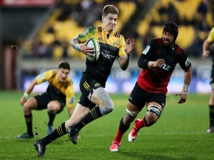 JORDIE BARRETT of the Hurricanes breaks away for a try during the Super Rugby match between the Hurricanes and the Crusaders at Westpac Stadium in Wellington, New Zealand.