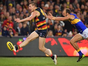 JOSH JENKINS of the Crows kicks the ball during the AFL match between the Adelaide Crows and the West Coast Eagles at AO in Adelaide, Australia.