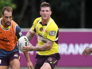 JOSH MCGUIRE passes the ball during the Brisbane Broncos NRL training session in Brisbane, Australia.