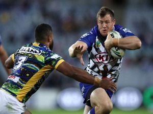 JOSH MORRIS of the Bulldogs runs the ball during the NRL match between the Canterbury Bulldogs and the Parramatta Eels at ANZ Stadiumin Sydney, Australia.