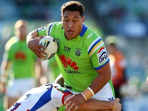 JOSH PAPALII of the Raiders runs the ball during the NRL match between the Canberra Raiders and the Newcastle Knights at GIO Stadium in Canberra, Australia.