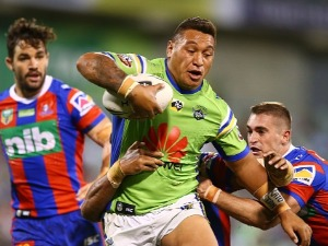 JOSH PAPALII of the Raiders is tackled during the NRL match between the Canberra Raiders and the Newcastle Knights at GIO Stadium in Canberra, Australia.
