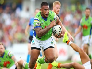 JUNIOR PAULO of the Raiders makes a line break during the NRL match between the Canberra Raiders and the Wests Tigers at GIO Stadium in Canberra, Australia.