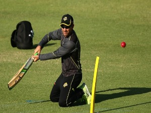 JUSTIN LANGER, coach of Western Australia hits balls for slips catching practice during the Sheffield Shield match between Western Australia and South Australia at WACA in Perth, Australia.