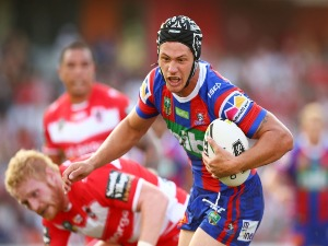 KALYN PONGA of the Knights runs the ball during the NRL match between the St George Illawarra Dragons and the Newcastle Knights at WIN Stadium in Wollongong, Australia.