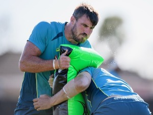 KANE DOUGLAS undertakes a training drill during an Australian Wallabies training session at Linwood Rugby Club in Christchurch, New Zealand.