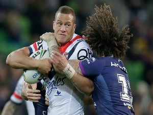 Kevin Proctor of the Storm tackles KENE EVANS of the Roosters during the round 20 NRL match between the Melbourne Storm and the Sydney Roosters at AAMI Park on July 23, 2016 in Melbourne, Australia.