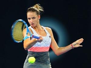 KAROLINA PLISKOVA of Czech Republic plays a forehand against Elina Svitolina of Ukraine during the 2018 Brisbane International at Pat Rafter Arena in Brisbane, Australia.