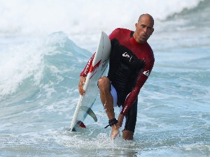 KELLY SLATER of the United States walks out of the water following an aerial expression session during Surfsho at Bondi Beach in Sydney, Australia.