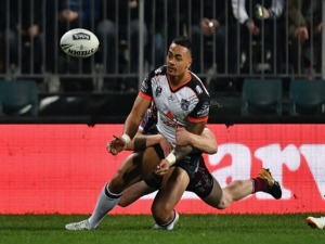 KEN MAUMALO of the Warriors offloads the ball during the NRL match between the Manly Sea Eagles and the New Zealand Warriors at AMI Stadium in Christchurch, New Zealand.