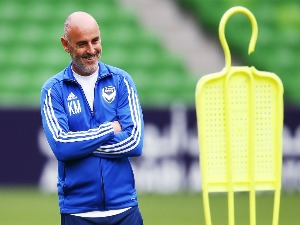 Victory head coach KEVIN MUSCAT looks upfield during a Melbourne Victory Training Session at AAMI Park in Melbourne, Australia.
