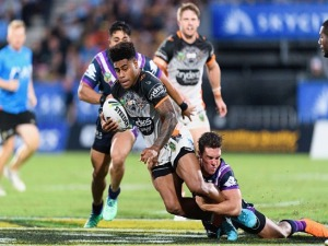 KEVIN NAIQAMA of the Tigers is tackled by Brodie Croft of the Storm during the NRL match between the Wests Tigers and the Melbourne Storm at Mt Smart Stadium in Auckland, New Zealand.