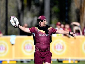 Coach KEVIN WALTERS calls out instructions to his players during a Queensland Maroons State of Origin training session at Sanctuary Cove in Brisbane, Australia.