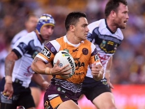 KODI NIKORIMA of the Broncos breaks away from the defence during the NRL match between the Brisbane Broncos and the North Queensland Cowboys at Suncorp Stadium in Brisbane,Australia.