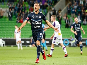 KOSTA BARBAROUSES of the Victory celebrates after scoring his sides third and winning goal during the A-League match between the Melbourne Victory and Perth Glory at AAMI Park in Melbourne, Australia.