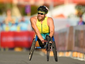KURT FEARNLEY of Australia celebrates as he races to the line to win gold in the Men's T54 marathon of the Gold Coast 2018 Commonwealth Games at Southport Broadwater Parklands in the Gold Coast, Australia.