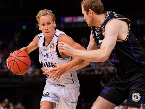 KYLE ADNAM of Melbourne controls the ball during the NBL match between the Sydney Kings and Melbourne United at Qudos Bank Arena in Sydney, Australia.