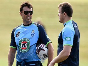 LAURIE DALEY speaks with JOSH MORRIS during a New South Wales Blues State of Origin training session in Coffs Harbour, Australia.