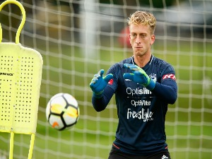 Victory goalkeeper LAWRENCE THOMAS takes part during a Melbourne Victory A-League training session at Gosch's Paddock in Melbourne, Australia.