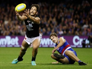 LEVI CASBOULT of the Blues and Zaine Cordy of the Bulldogs in action during the 2018 AFL match between the Western Bulldogs and the Carlton Blues at Etihad Stadium in Melbourne, Australia.