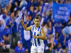 LINDSAY THOMAS of the Kangaroos celebrates after kicking a goal during the AFL match between the North Melbourne Kangaroos and the Port Adelaide Power at Etihad Stadium in Melbourne, Australia.