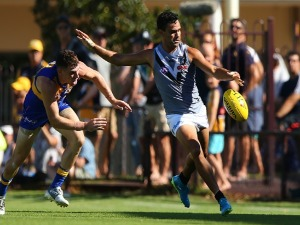 LINDSAY THOMAS of the Power passes the ball during the JLT Community Series AFL match between the West Coast Eagles and the Port Adelaide Power at Leederville Oval in Perth, Australia.
