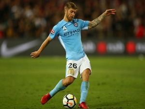 LUKE BRATTAN of City kicks the ball during the A-League match between the Western Sydney Wanderers and Melbourne City at ANZ Stadium in Sydney, Australia.