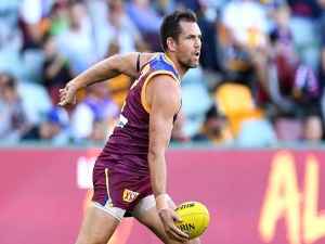 LUKE HODGE of the Lions handballs during the warmp-ups before the AFL match between the Brisbane Lions and the Hawthorn Hawks at The Gabba in Brisbane, Australia.