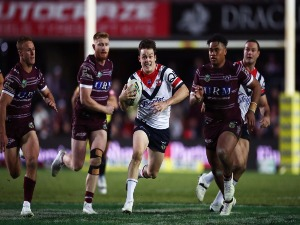 LUKE KEARY of the Roosters makes a break during the NRL match between the Manly Sea Eagles and the Sydney Roosters at Lottoland in Sydney, Australia.