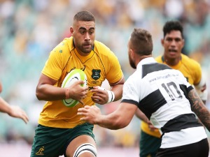 LUKHAN TUI of the Wallabies runs at Quade Cooper of the Barbarians during the match between the Australian Wallabies and the Barbarians at Allianz Stadium in Sydney, Australia.