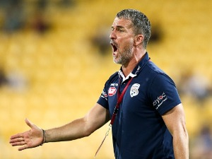 Coach MARCO KURZ of Adelaide United talks to his players during the A-League match between the Wellington Phoenix and Adelaide United at Westpac Stadium in Wellington, New Zealand.