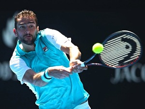 MARIN CILIC of Croatia plays a backhand against Joao Sousa of Portugal of the 2018 Australian Open at Melbourne Park in Australia.